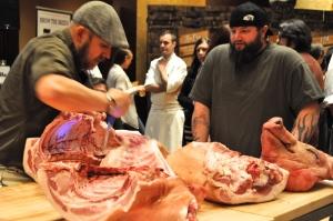 Jason Nauert breaking down a whole hog. Photo by Sandra Morriss.