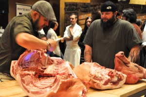 Jason Nauert breaking down a whole hog. Photo by Sandra Morriss.